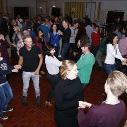 Group of people on the dance floor learning their Irish steps at a Irish Dancing Workshop orgnaised by Creative Events