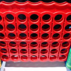 Large scale red connect 4 game at a City Challenge Event organised by Creative Events