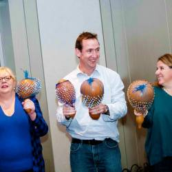 People shaking maracas at a Creative Events Drum 4 Fun event
