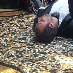 Actor lying on the floor pretending to be dead at the Crime Scene Investigation event organised by Creative Events.