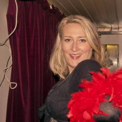 Actor with red feather boa having fun at Creative Events Murder Mystery Pub Crawl