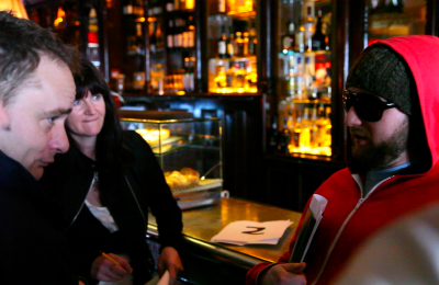 Woman interacting with Actor at the bar at Creative Events Murder Mystery Pub Crawl