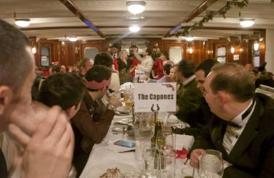 Guests sitting at a dinner table at at Creative Events Murder Mystery Show