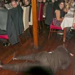 An actor lying on the floor after pretending to die at at Creative Events Murder Mystery Show