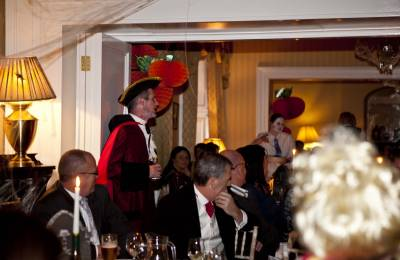 Actors speaking to guests at at Creative Events Murder Mystery Show