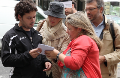 Teams reading the question booklet at a Creative Events Treasure Hunt
