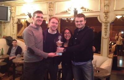 A winning team holding the trophy at a Creative Events Treasure Hunt