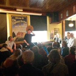 Two musicians on stage speaking about the Bodhran at a Creative Events Bodhrán Session