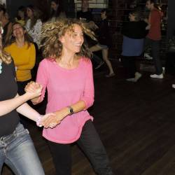 A women dancing with a partner at a Creative Events Interactive Irish Ceili