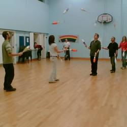 A group learning to juggle at a Creative Events Juggling Workshop