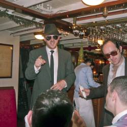 The 2 detectives are questioning members of the group in order to rule them out of the crime , organised by Creative Events