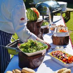 Chef's serving food at a Creative Events BBQ