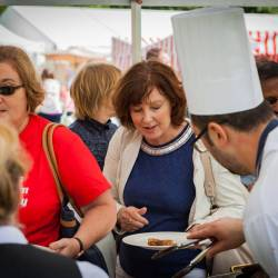 People choosing food at a Creative Events BBQ