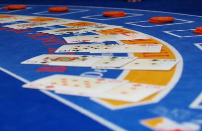 playing cards on a blackjack table at a Creative Events Casino party