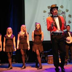 Irish dancers and a host on stage at a Creative Events Irish Gala Dinner