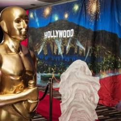 A large scale Oscar trophy beside a red carpet and Hollywood backdrop , organised by Creative Events
