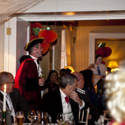Our actors walking around the room getting people involved in the Murder Mystery , organised by Creative Events