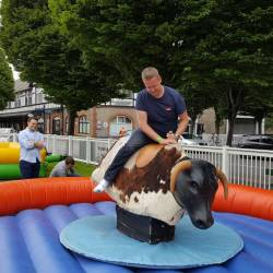 A man on a inflatable rodeo bull