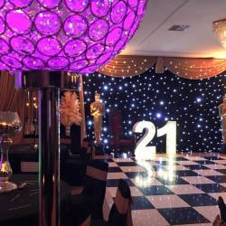 A 21st anniversary sign in front of a fairylight backdrop at a Creative Events Oscars Night