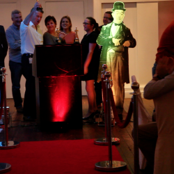 Red carpet walkway leading to a podium with people collecting their awards , organised by Creative Events