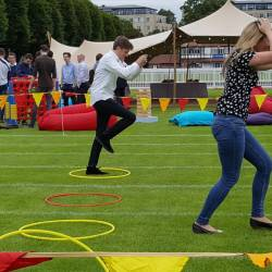 People doing relay races at a Creative Events Summer Sports Day