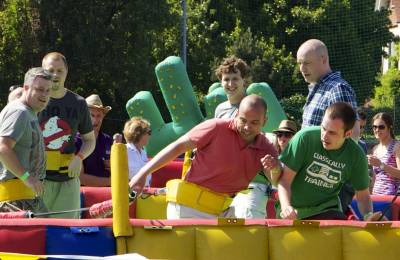 A man playing on an inflatable foosball game at a Creative Events Old School Sports Day
