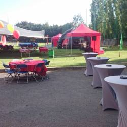 Tables set up in front of a marquee at a Creative Events BBQ