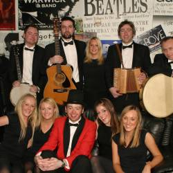 A group shot of musicians, dancers and the host at a Creative Events Irish Gala Dinner