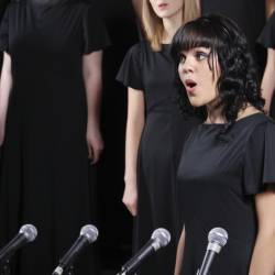 A woman singing at a Creative Events Instant Choir