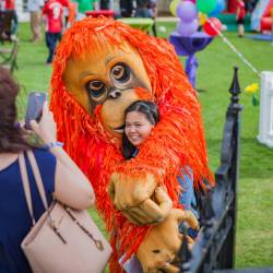 A orangutan character posing for a photo at a Creative Events Summer Family Fun Day