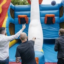 People playing basketball on an inflatable