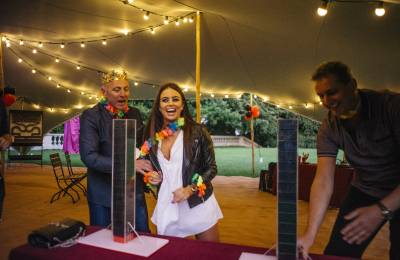 2 People playing the Tower Stack game in tent