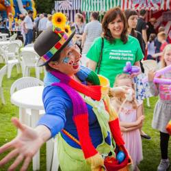An animated clown balloon modeller at a Creative Events Summer Family Fun Day