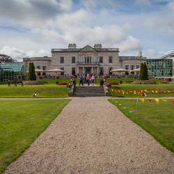 The grounds of the Radisson Blu St. Helen's Hotel, Dublin with coloured bunting placed around the garden.