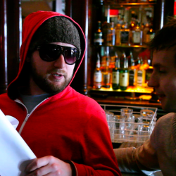 The mole character in a red hoodie with glasses being interrogated by the detectives for information , organised by Creative Events