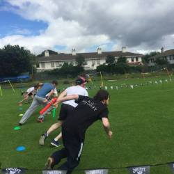 Teams competing in a baton relay race at a Creative Events Old School Sports Day