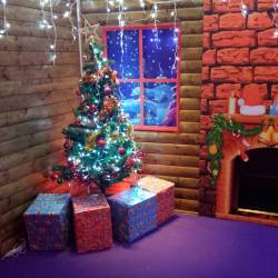 Presents under a tree in a Creative Events Santa's Grotto