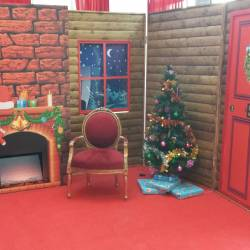 Big red chair in a Creative Events Santa's Grotto
