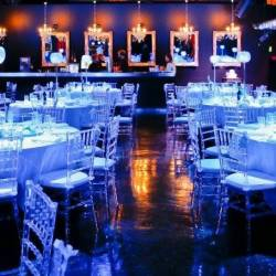 Round tables with blue lighting and white decorations at a Creative Events Winter Wonderland event