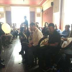 A group learning the Irish Bodhran at a Creative Events City Challenge