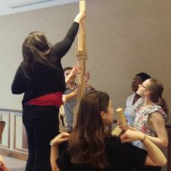 A team building a giant jenga structure at a Creative Events Company Challenge