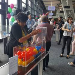 A woman playing ball sort at a Creative Events Cube Challenge