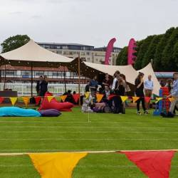 A stretch tent and giant beanbags setup at a Creative Events Summer Sports Day