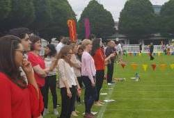 People cheering on relay racers at a Creative Events Team Building Sports Day