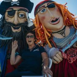 A woman poses with two pirate chacters at a Creative Events Summer Family Fun Day