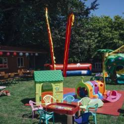 A children's area with soft play toys and inflatables at a Creative Events Summer Family Fun Day
