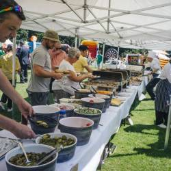 Food being served at a Creative Events Summer Carnival and BBQ