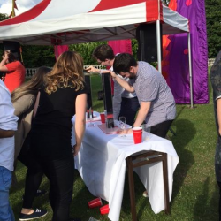 Two people competing in a tower block game at a Creative Events Summer Party