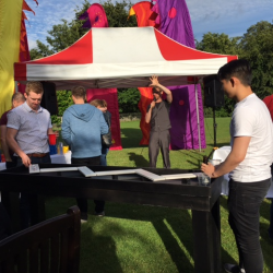 People playing a wooden puzzle game at a Creative Events Summer Party
