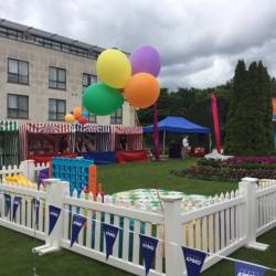 A fenched off area with giant games at a Creative Events Summer Party